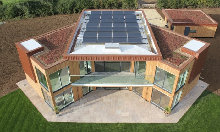 10 examples of energy efficient container homes for Solar powered home designs