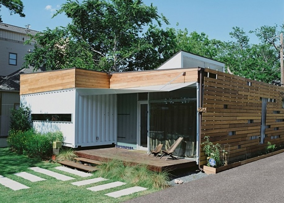 enchanting-design-of-shipping-container-made-of-the-wooden-materials-feat-the-metal-paint-wall-with-small-terrace-which-has-beige-path-915x655
